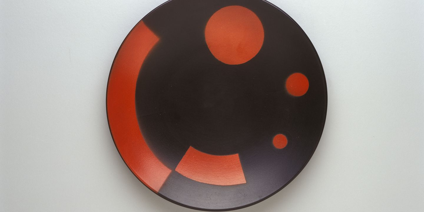 2003/137/1 Plate, unglazed earthenware, designed by El Lissitzky, Germany, c.1923. Click to enlarge.