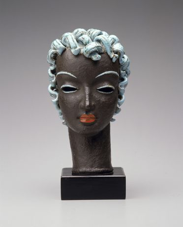 2005/66/10 Sculpture, womans head, terracotta / wood / metal, probably modelled by Rudolf Knoerlein, made by the Goldscheider Porcelain Works and Majolica Factory, Vienna, Austria, 1925-1930