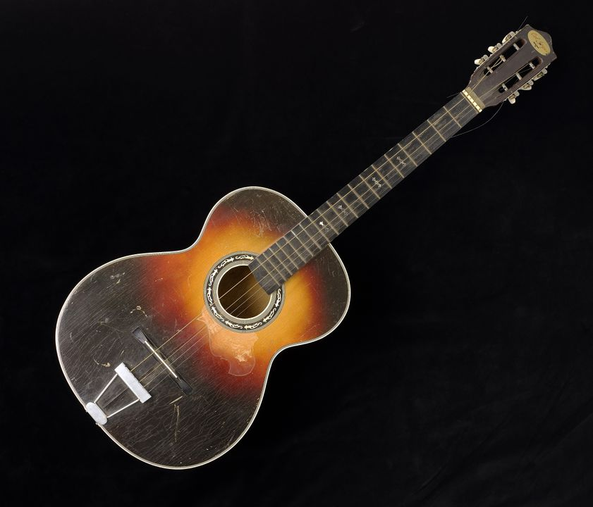 2007/68/1 Acoustic guitar, 'Col Joye Model', wood / metal / plastic, maker unknown, Japan, 1960-1970. Click to enlarge.