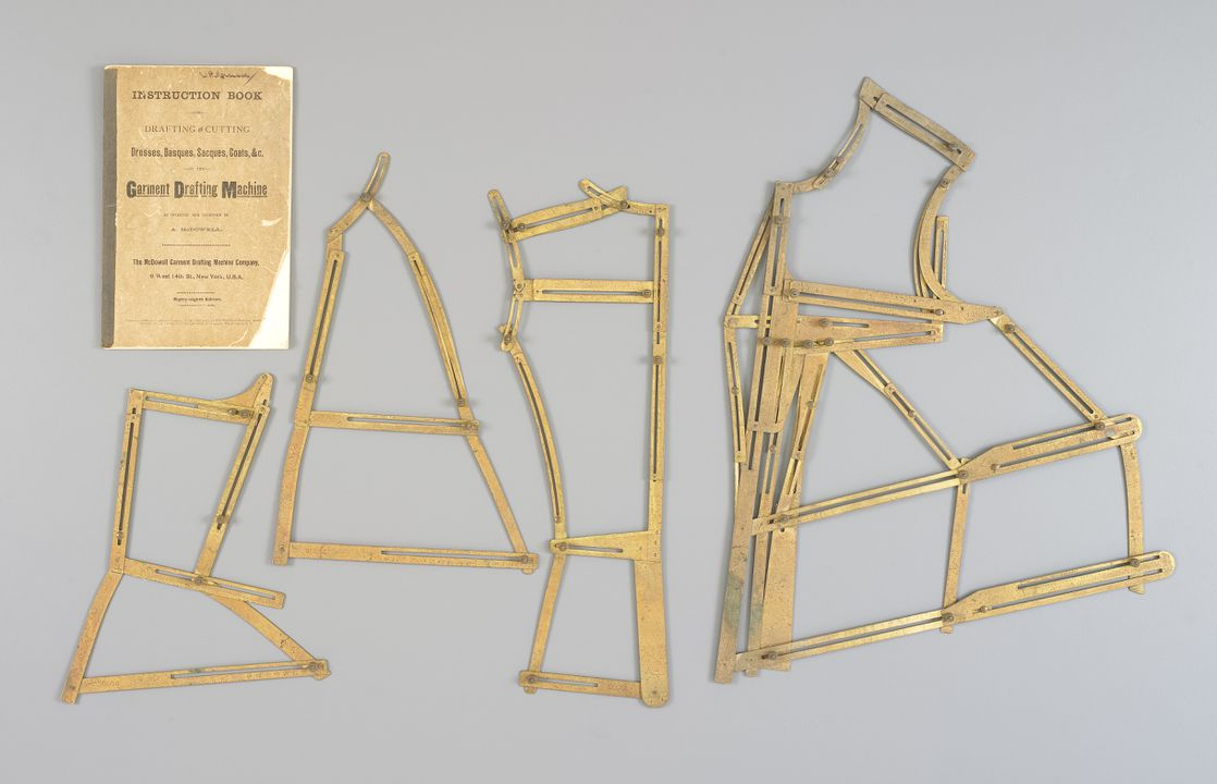 2007/133/1 Garment drafting machine, consisting of back, side, underarm and front pieces, and instruction book, brass / paper / material, made by McDowell Garment Drafting Machine Company, New York, New York, United States of America, 1891. Click to enlarge.