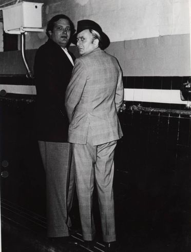 97/272/1-2/14 Photographic print, black and white, 'Taking a leak', Clyde Packer and Barry Humphreys at urinals in Luna Park, by Janice Wakely, Sydney, New South Wales, Australia, 1976