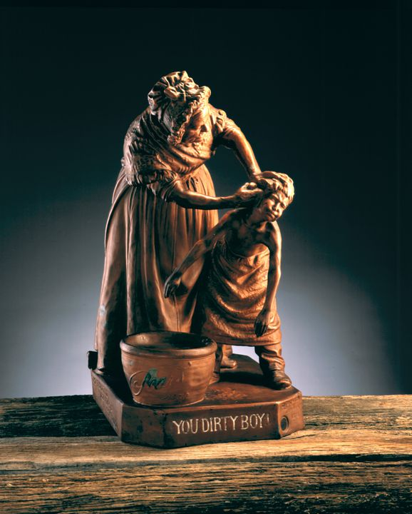 A8591 Statuette, 'You Dirty Boy!', stamped metal, designed by Giovanni Focardi, made by Wunderlich Limited, Redfern, Sydney, 1908-1920, to advertise Pears soap. Click to enlarge.