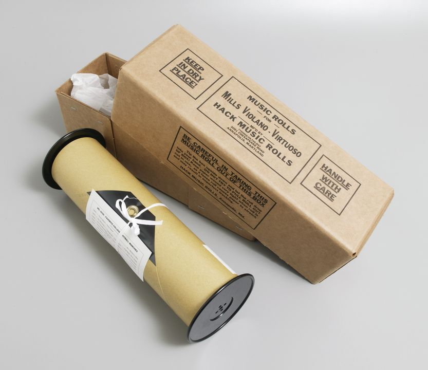 2003/8/10D Music roll in box, Violano Virtuoso, 'No. 2929 - Favorite College Football Marches', paper / cardboard / plastic / metal, music roll made by The Playrite Music Roll Company for Hack Music Rolls, Annapolis, Maryland, USA, box made by Longview Fi. Click to enlarge.