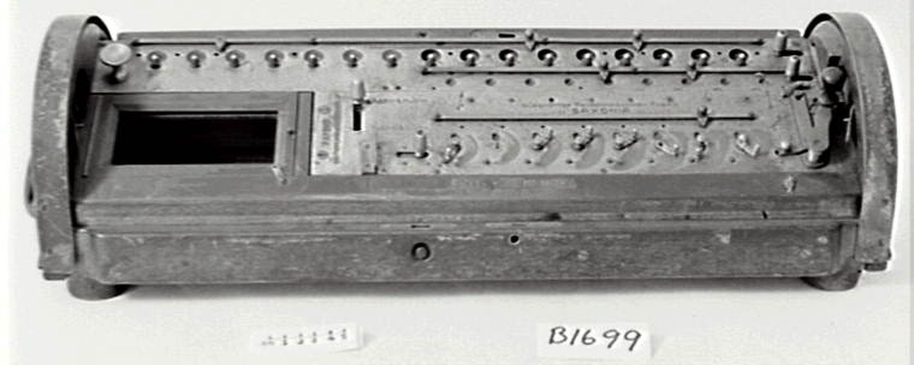 B1699 Mechanical calculator, 'Saxonia', wood / brass, made by Glashutter Rechenmaschinen-Fabrik, Saxony, Germany, possibly 1880s. Click to enlarge.