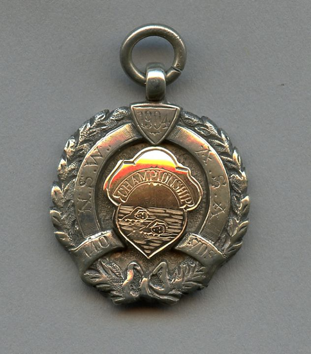 N18092 Medal, 1904 NSW ASA Championship 440 yards, silver, made by William Kerr, won by Barney Kieran, Sydney, New South Wales, Australia, 1904. Click to enlarge.