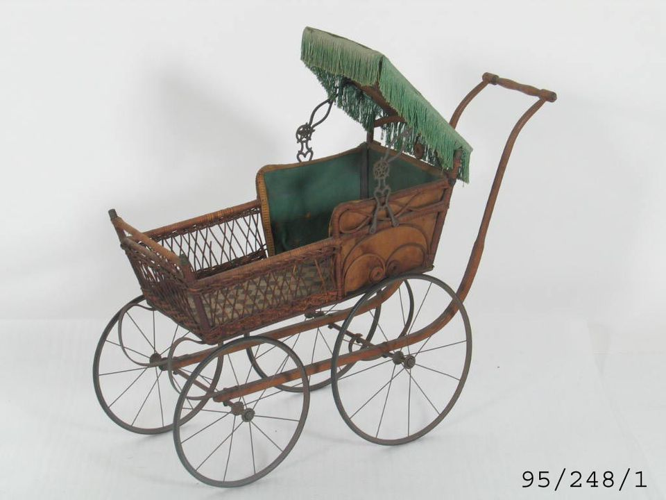 95/248/1 Toy, dolls pram, wood / metal, maker unknown, [England], 1900-1940. Click to enlarge.