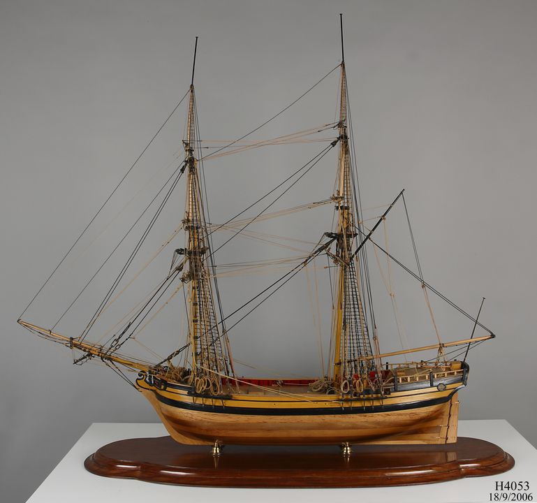 H4053 Ship model, HM Armed Brig 'Supply', 1:24 scale, wood / cotton and synthetic threads, made by Geoffrey Ingleton RAN, for sesquicentenary of arrival of First Fleet, Sydney, New South Wales, Australia, 1937-1938. Click to enlarge.