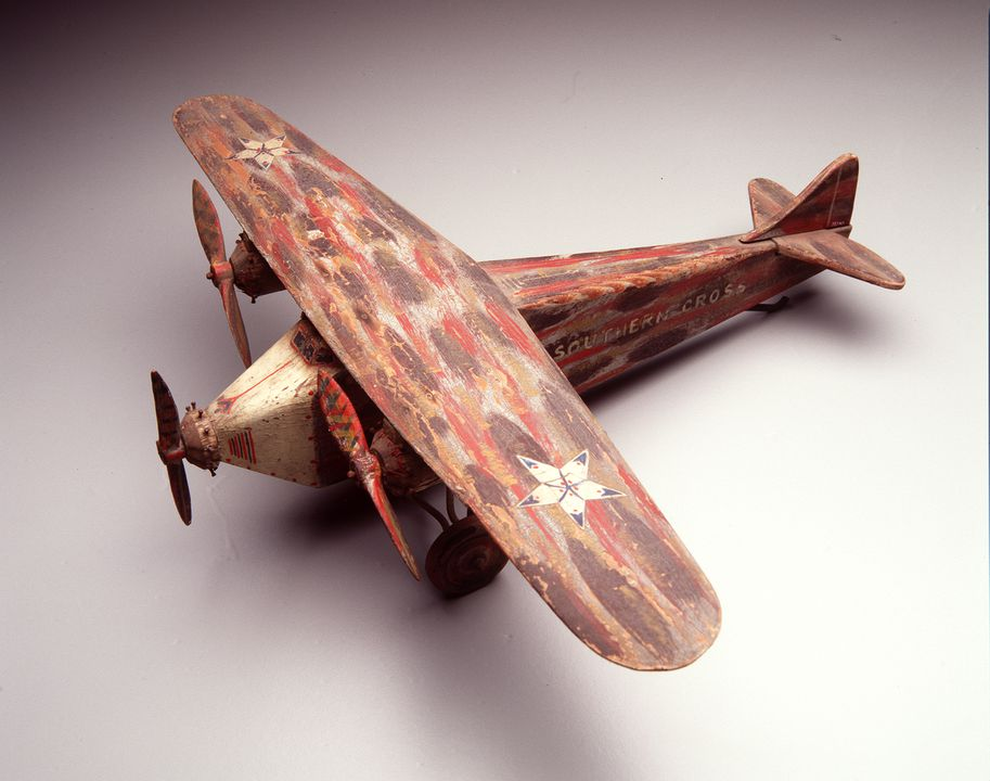 98/14/1 Toy aircraft, representing Fokker trimotor 'Southern Cross' flown by Charles Kingsford Smith and Charles Ulm, wood/metal, unknown designer/manufacturer, Australia, 1928-1929, used by William Swinbourne. Click to enlarge.