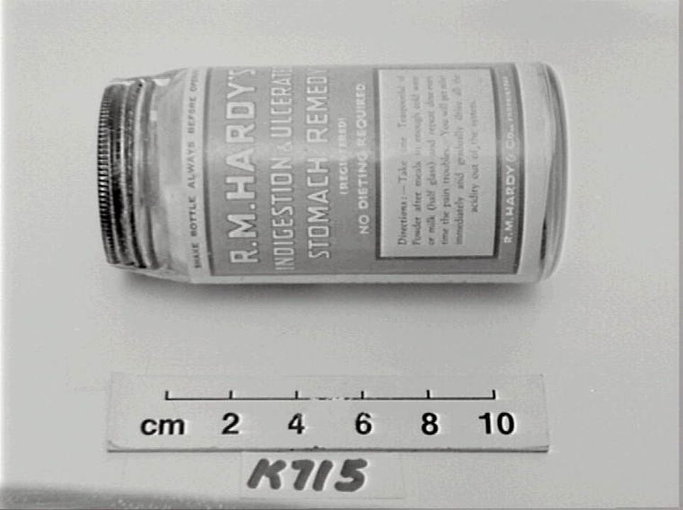 Jar of Hardy's Indigestion Medicine and contents, clear glass jar