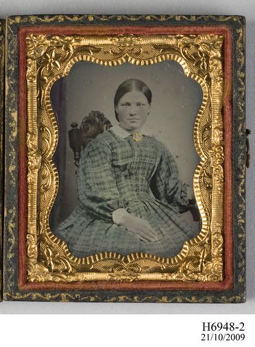 H6948-2 Photographic positive, hand-tinted ambrotype in case, studio portrait of Mrs. Urquhart, collodion / paint / glass / wood / paper / metal / velvet, photographer unknown, 1854-1865