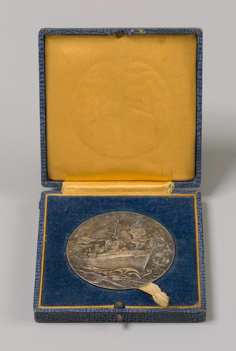 N19261 Medal (-1) in case (-2), Australia: NSW, commemorative, presented by the City of Sydney to Captain J.A. Collins C.B.,R.A.N. for the sinking of B Colleoni by HMAS Sydney, 1940.. Click to enlarge.