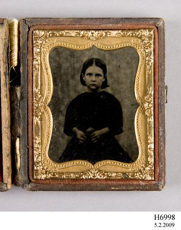 H6998 Photographic positive, hand-tinted ambrotype in case, studio portrait of a six year old girl Ann Plummer, collodion / paint / glass / wood / paper / metal / velvet, photographer Edward Irby [attributed], Northern New South Wales, Australia, 1862-1864