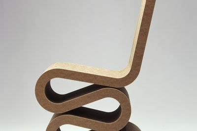 2003/83/1 Chair, 'Wiggle', cardboard, designed by Frank Gehry, United States, 1972, made by Vitra, Germany, 2002.