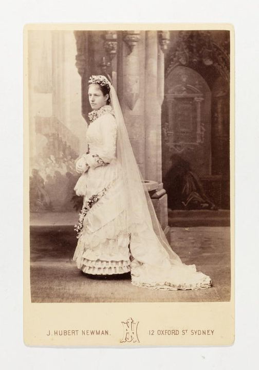 P3576-1 Photograph (1 of 38), carte de visite, woman in wedding dress, paper / card, photographed by J Hubert Newman, Sydney, New South Wales, Australia, c. 1880. Click to enlarge.