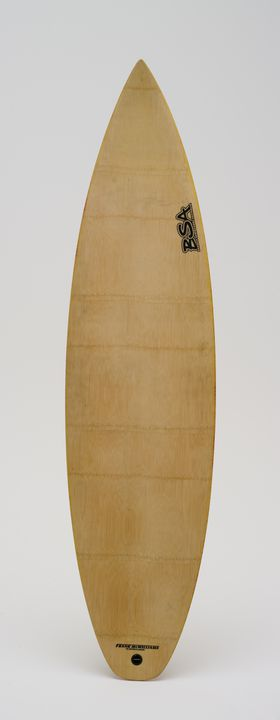 2005/222/1 Surfboard and fins (3), 'Bambu', rounded and standard short model, polystyrene foam / bamboo veneer / epoxy resin, designed and made by Mei Yap Gordon and Shale Gordon, Byron Bay, New South Wales, Australia, 2001-2002. Click to enlarge.