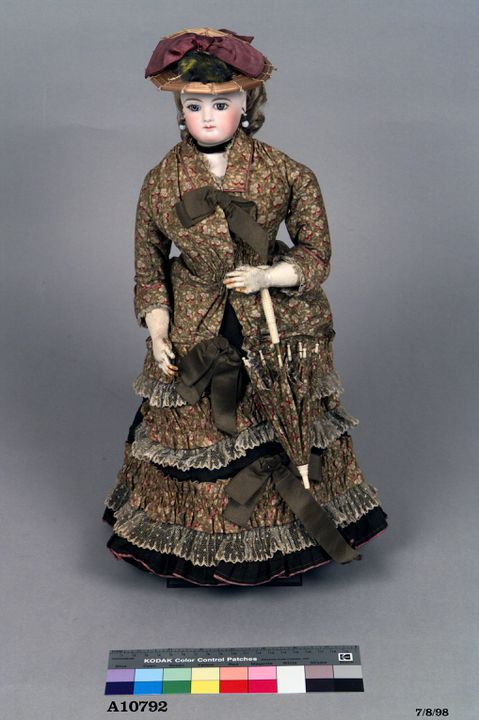A10792 Doll, clothing and accessories, female, designed and made by Edouard Chauviere, France, 1870-1880. Click to enlarge.