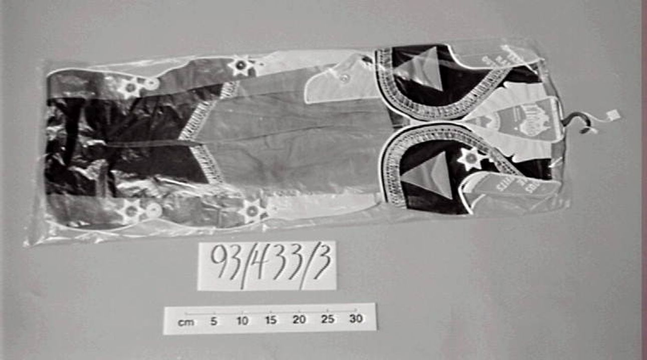 93/433/3 Fancy dress costume and packaging, children's, cowboy, vinyl/cotton/cardboard/plastic, A L Lindsay & Co Pty Ltd, Leichhardt, New South Wales, Australia, 1965-1975. Click to enlarge.