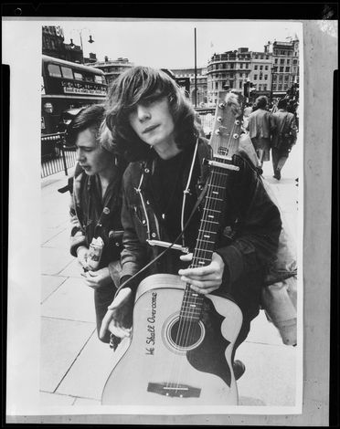 96/44/1-2/1 Photographic print, black and white, young man with guitar and harmonica, paper, David Mist, London, 1959-1965