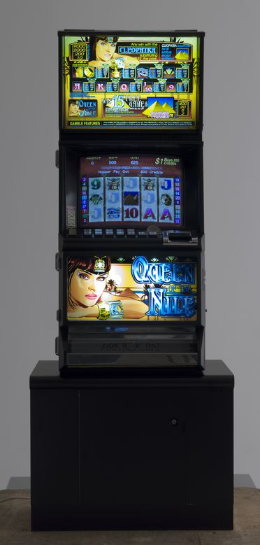 2006/38/1 Poker machine with stand and accessories, electronic, 'Queen of the Nile', Mark 1, metal / glass / plastic, designed and made by Aristocrat Technologies Australia Pty Limited, Sydney, New South Wales, Australia, 1997-2006