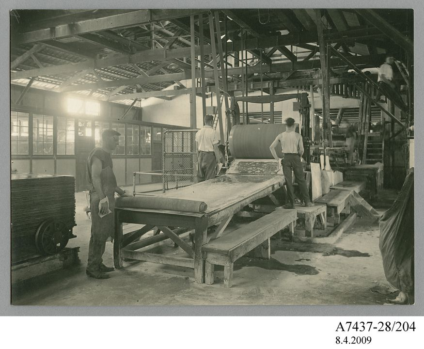 A7437-28/204 Photographic print, black & white, workmen rolling out Durabestos at Wunderlich Limited's factory in Cabarita, New South Wales, Wunderlich Limited, Redfern, New South Wales, Australia, 1927. Click to enlarge.