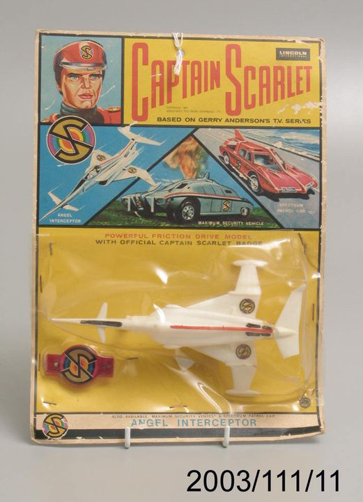 2003/111/11 Toy, Angel Interceptor jet and badge with packaging, licensed from the television show 'Captain Scarlet and The Mysterons', plastic / card / metal, Lincoln International, New Zealand, 1967. Click to enlarge.