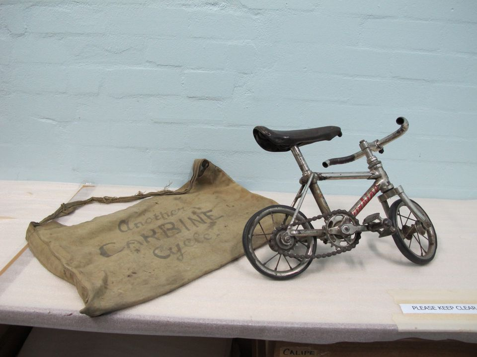 2004/76/1 Bicycle, miniature, theatrical prop, with canvas bag, metal / leather / rubber / canvas, made by Carbine Cycles, used by Fred Klimo the clown, Australia, 1936-1939. Click to enlarge.