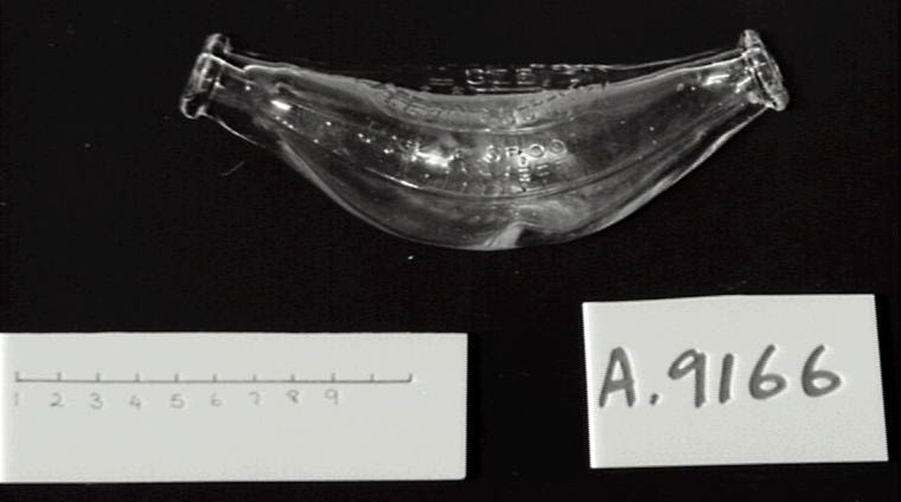 A9166 Feeding bottle, press moulded, glass, maker not recorded, Sydney, New South Wales, Australia, 1930-1939. Click to enlarge.