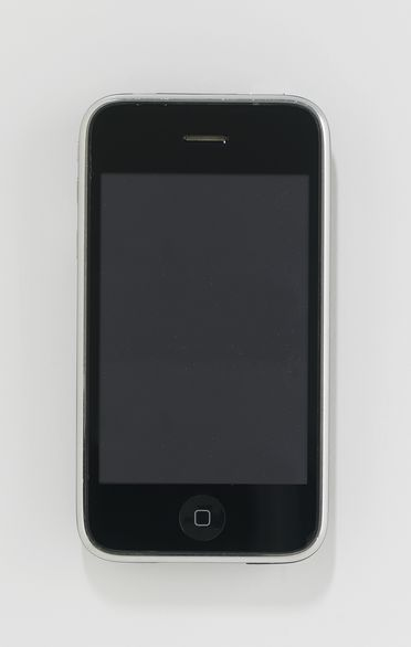 2012/116/1 Mobile phone and packaging, Apple iPhone 3GS 16GB, plastic / metal / glass / electronic components / paper, designed by Sir Jonathan Ive and the Apple Industrial Design group, California, United States of America, made for Apple Inc by Foxconn, Shenzhen, Guangdong, China, 2008
