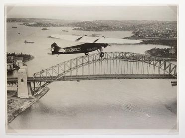 P2714 Photograph, black and white print, 'Southern Cross' flying over Sydney Harbour, paper, photographer unknown, Sydney, New South Wales, Australia, 1933