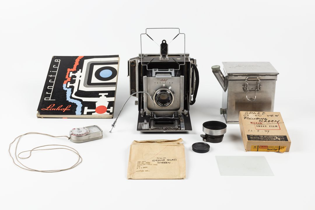 2011/59/1 Camera, 'Linhof Technika', and accessories, metal / plastic / paper / glass, various makers, c. 1959, camera body used by Max Dupain, Sydney, New South Wales, 1959-1980s. Click to enlarge.