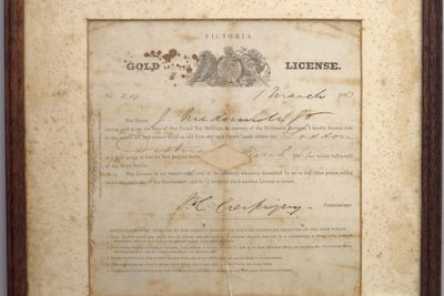 2000/128/1 Licence for gold mining, framed, paper / wood / glass, issued to J McDonnell, printed by John Ferres, Government Printing Office, Victoria, Australia, 1853