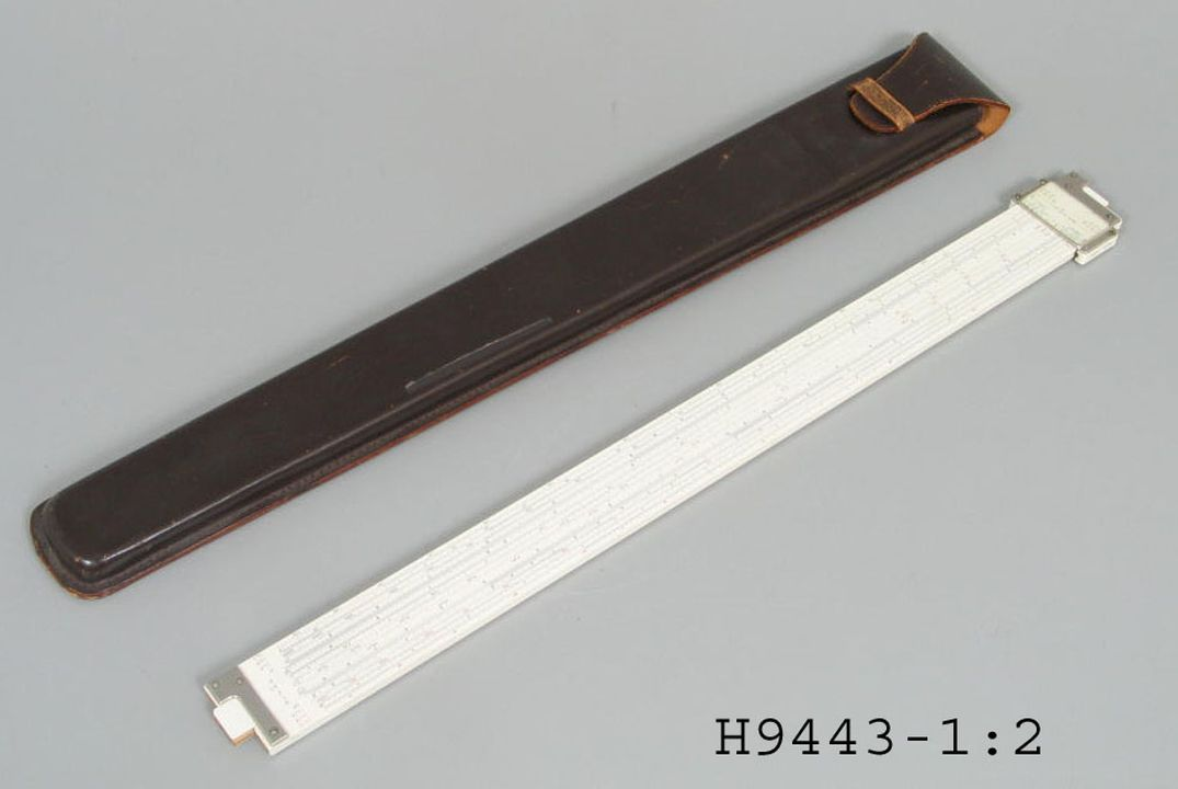 H9443 Slide rule and case, bamboo / plastic / metal / leather, designed and made by Hemmi, Japan, 1955-1965. Click to enlarge.