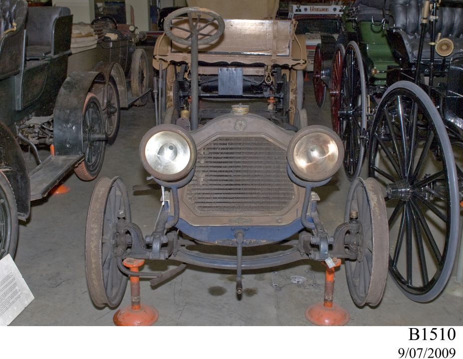 B1510 Automobile, full size, De Dion Bouton, 12 hp, 4-cylinder, mainly chassis & seats, no body, made by De Dion Bouton & Cie, Paris, France, before 1908, used by Dr Robert Meredith Farrell, Quirindi and Pymble, NSW, Australia, 1908-1947. Click to enlarge.