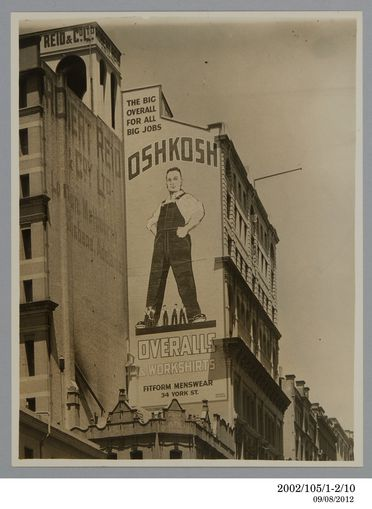 2002/105/1-2/10 Photographic print, black and white, large wall advertising sign for Fitform Menswear advertising Oshkosh overalls and workshirts along King Street, Sydney, designed by Rousel Studios, Sydney, New South Wales, Australia, c 1930