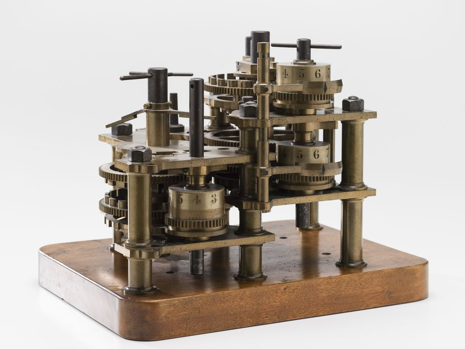 96/203/1 Calculating engine, specimen piece, with instructions and engraving, 'Difference Engine No1', bronze / steel / wood / paper, designed by Charles Babbage, parts made by Joseph Clements, assembled by Henry Provost Babbage, England, 1822-1879. Click to enlarge.