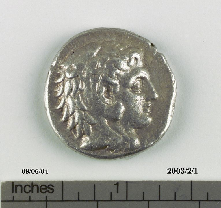 2003/2/1 Coin, tetradrachm, Kingdom of Alexander III (336-323BC), issued posthumously, in name of Philip III, silver (17.072 grams) from the Persian Treasuries, Babylon Mint (modern Iraq), 323-317 BC. Click to enlarge.