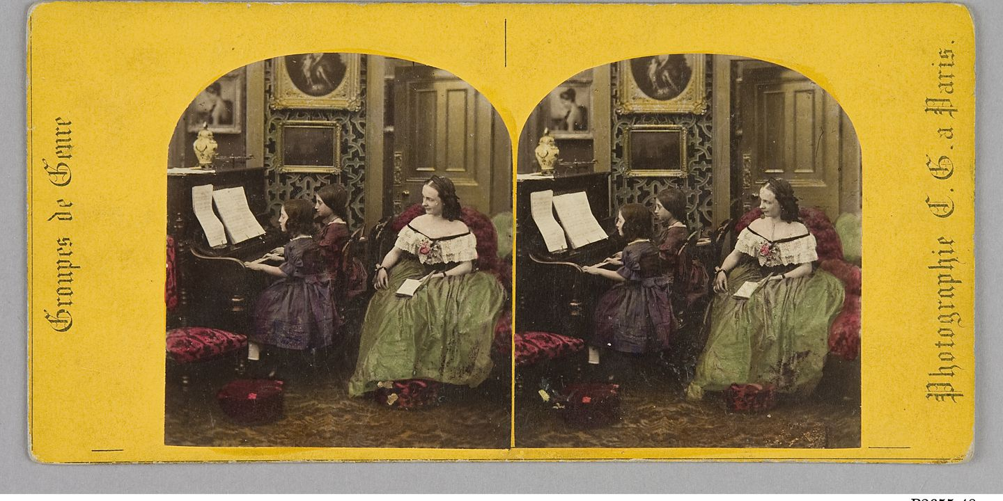 P2655-48 Photographic print (stereoscopic), interior view, children playing a piano, mounted on yellow card, paper / albumen / silver, published by Photagraphie C.G. a Paris, Paris, France, 1860-1890. Click to enlarge.