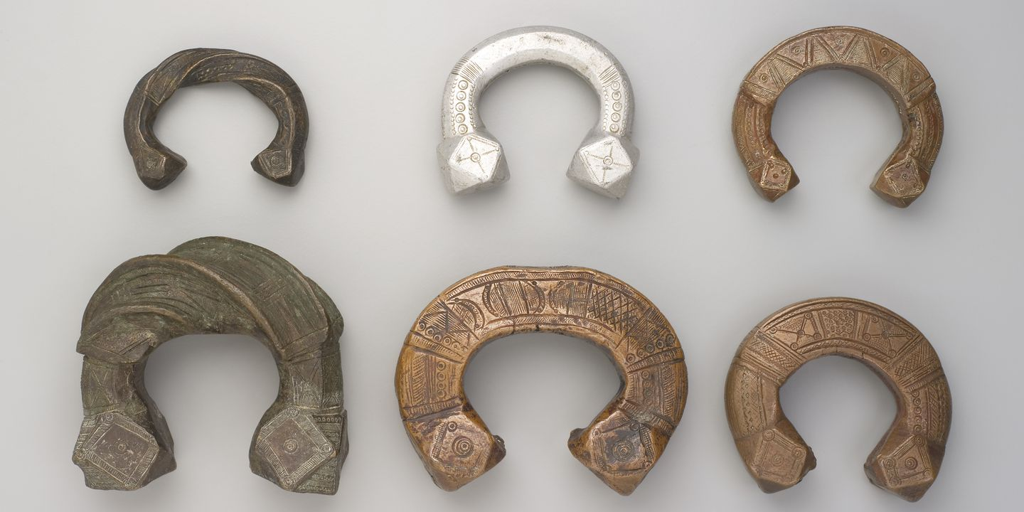 2008/75/2 Manilla jewellery / currency (6), U shaped style, brass / copper alloy, maker unknown, West Africa, 1850-1950. Click to enlarge.