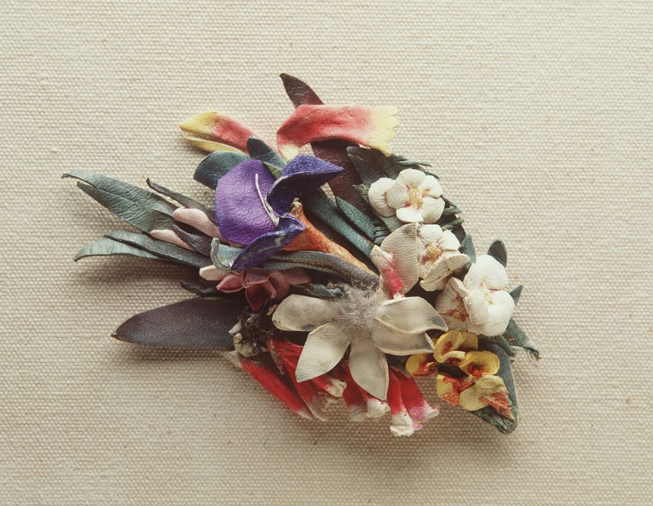 A8649 Brooch, Australian wildflowers, painted kid leather / wool, made by Lucie Dalgarno, Sydney, New South Wales, Australia, 1920-1930. Click to enlarge.