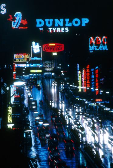 96/44/1-5/4/179 Transparency, colour, in cardboard mount, Kodachrome, William Street at night, for the book 'Sydney, A Book of Photographs', 35mm acetate film, photograph by David Mist, transparency processed by Kodak, Sydney, New South Wales, Australia, 1969