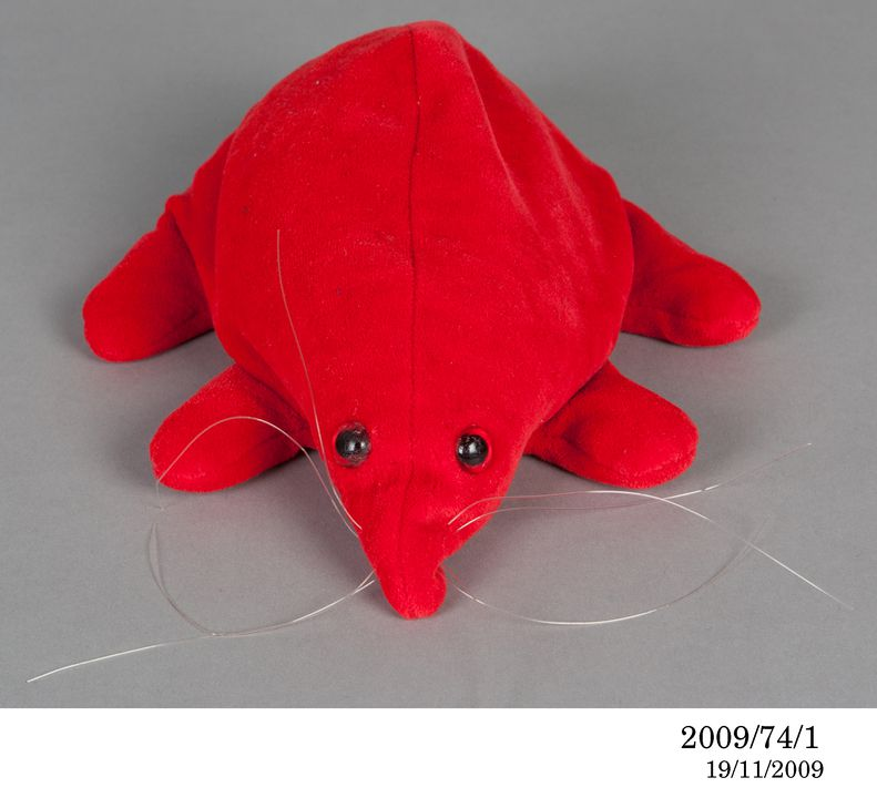 2009/74/1 Puggle soft toy in a bag, red / blue, synthetic textile / plastic / metal, Mattel Toys, United States of America, c. 1983. Click to enlarge.