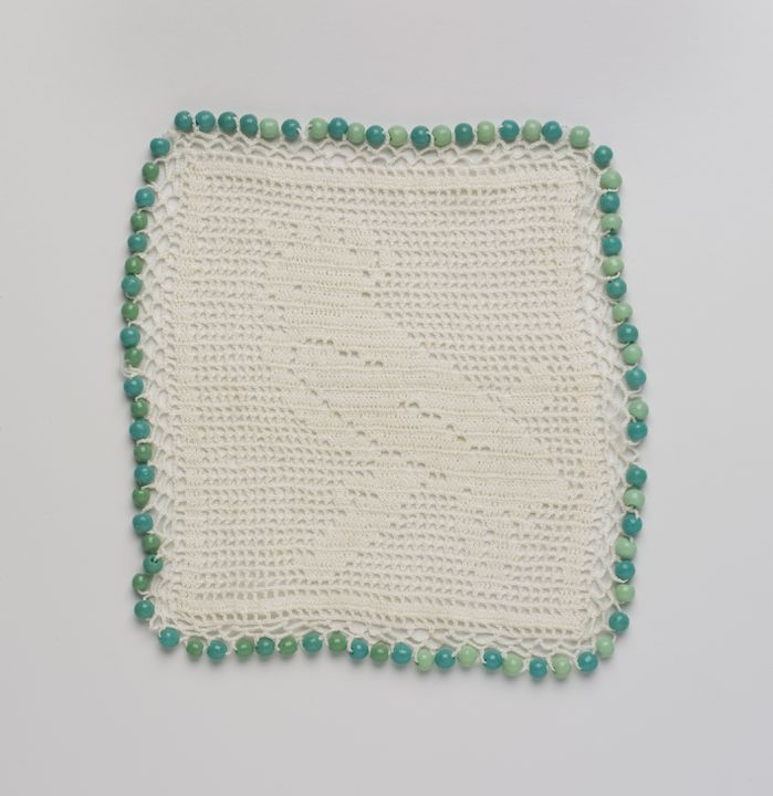 2010/11/2 Milk jug cover, with cockatoo motif, filet crochet, cotton / plastic, made in Australia, 1910-1930. Click to enlarge.