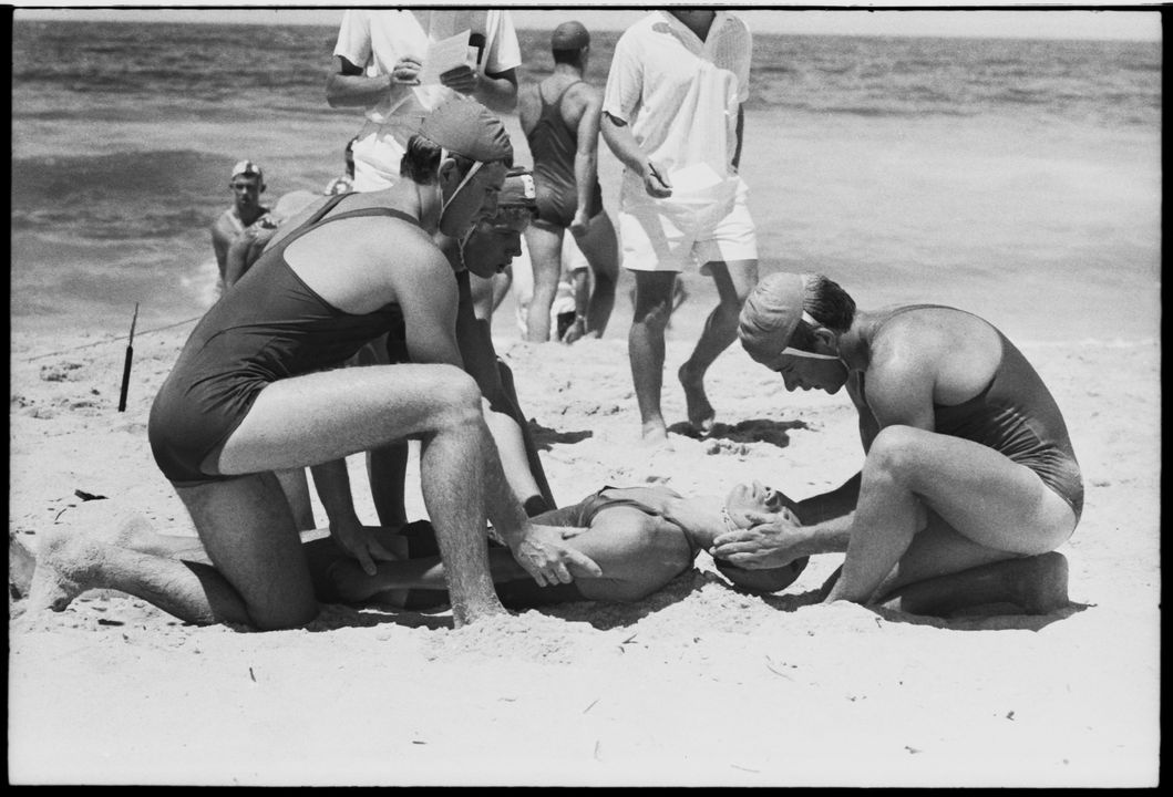 96/44/1-5/4/157/1 Negative, black and white, surf lifesavers practising resuscitation on beach, for the book 'Sydney, A Book of Photographs', 35mm acetate film, David Mist, Sydney, New South Wales, Australia, 1969. Click to enlarge.