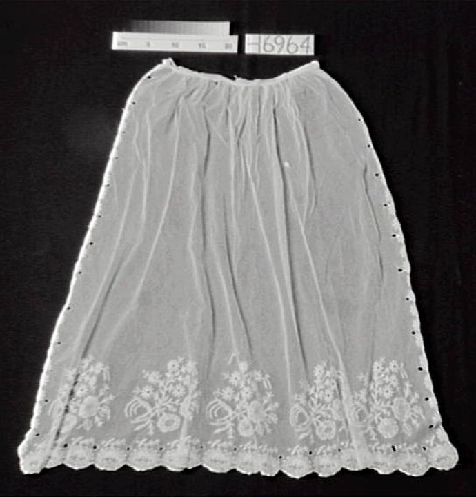 H6964 Apron, woman's, embroidered net, [England], 1840-1860.(OF). Embroidered net apron, c. 1850.(SB).. Click to enlarge.