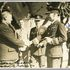 Image 1 of 1, 85/112-40 Photograph, black and white, Charles Kingsford Smith handing over the Southern Cross, paper, photographer unknown, Richmond, New South Wales, Australia, 1935. Click to enlarge