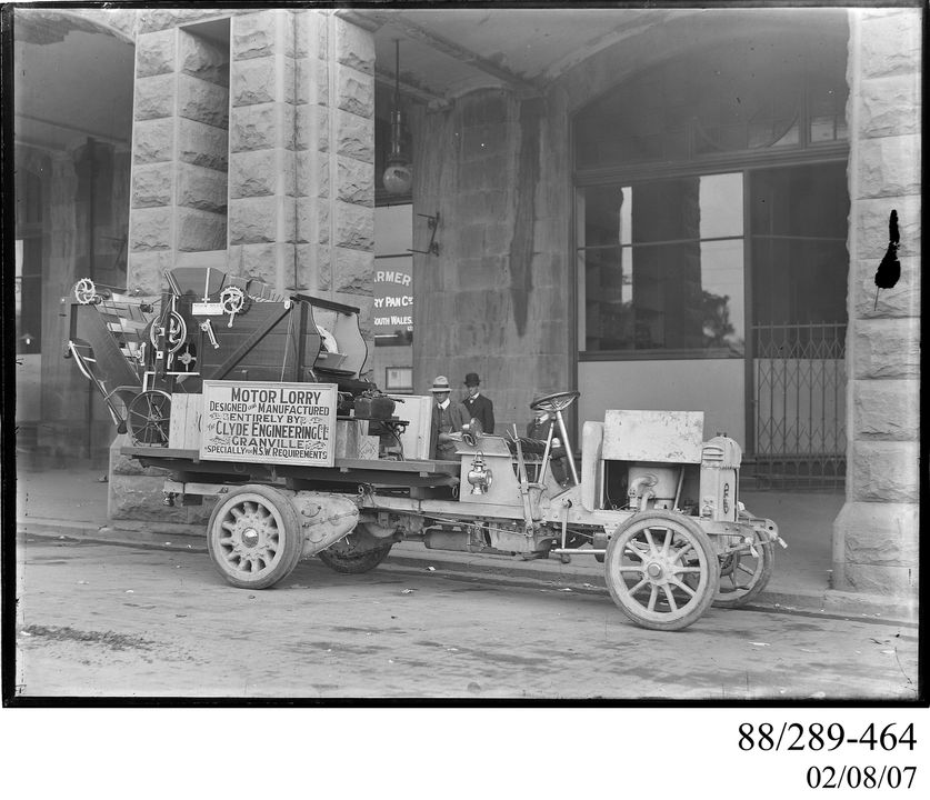 88/289-464 Photographic glass plate negative of a two-cylinder petrol motor truck carrying a winnower outisde Central railway station, Sydney, New South Wales, Australia, made byThe Clyde Engineering Co Ltd, Granville, New South Wales, Australia, 1900-1920. Click to enlarge.