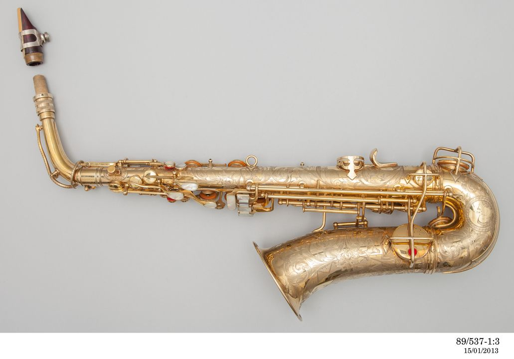 89/537 Alto saxophone, brass / mother-of-pearl, made by J E Becker of Adelaide for C G Conn, Elkhart, Indiana, United States of America, 1926. Click to enlarge.