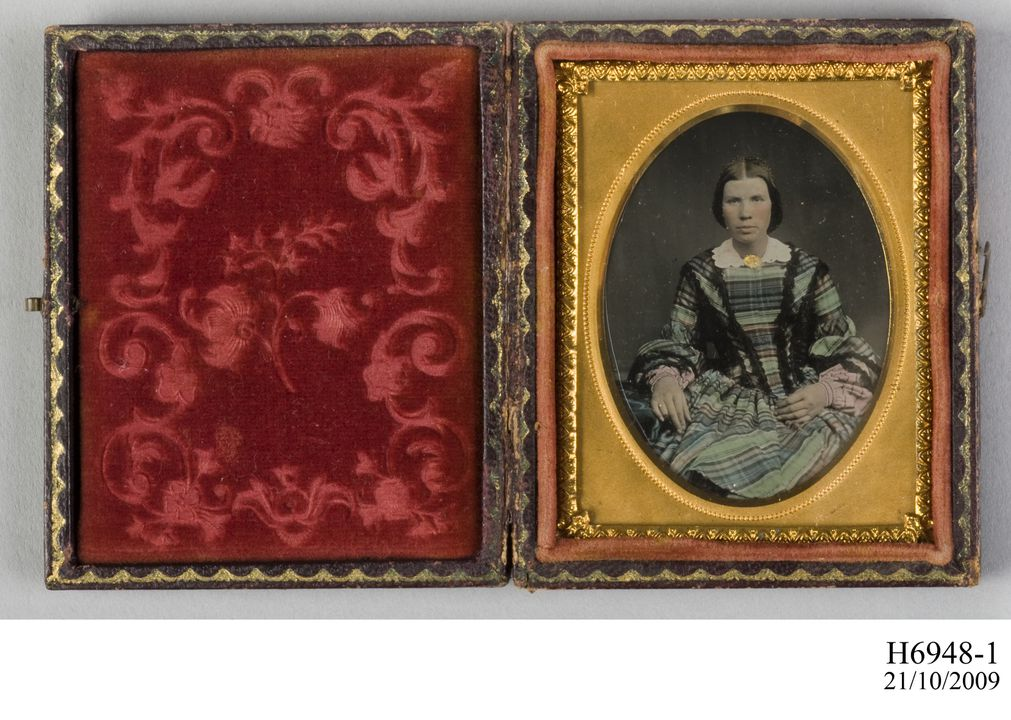 H6948-1 Photographic positive, hand-tinted ambrotype in case, studio portrait of a Mrs C A Ross, collodion / paint / glass / wood / paper / metal / velvet, photographer unknown, 1854-1865. Click to enlarge.