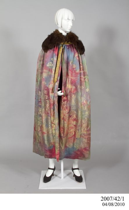 2007/42/1 Opera cape, womans, silk / metallic thread / fur, made by Liberty and Company, London, England, 1920-1925. Click to enlarge.