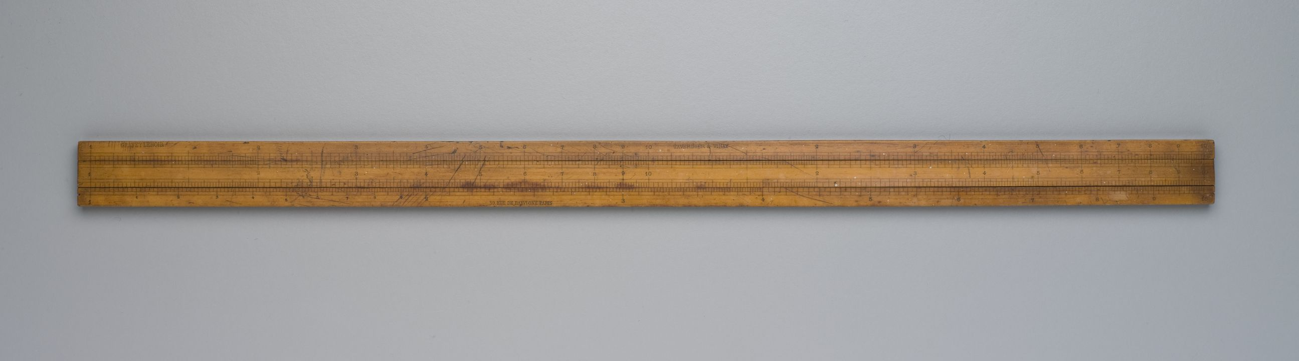2010/1/410 Slide rule, Soho type, with single-sided closed frame and double-sided slide, laminated wood, designed for Boulton and Watt, Soho, Birmingham, England, 1779, made by Gravet Lenoir's successor company Tavernier and Vinay, Paris, France, 1870-1882. Click to enlarge.